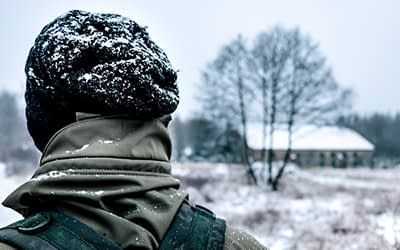 Wearing a hat helps you stay warm during a hike