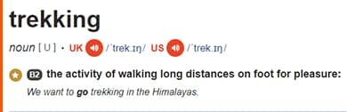 The definition of trekking by the Cambridge Dictionary, to understand the difference between hiking vs trekking vs mountaineering