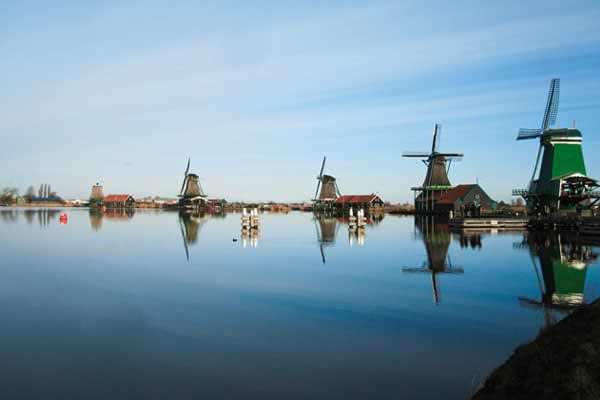 Zaanse schans is a popular touristic attraction for people visiting the netherlands ; traditional dutch culture